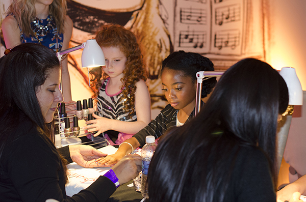 skai jackson from jesse at Muppets Most Wanted Party getting nails done by OPI