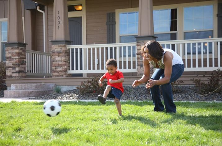 Mom & Son Playing Soccer