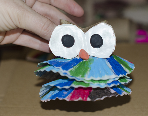 Glue on owl eyes