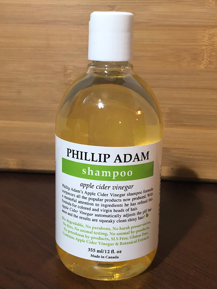 Apple cider vinegar is praised for being rich in vitamins and minerals good for hair, like vitamin C and B. Some also claim it contains alpha-hydroxy acid which helps exfoliate scalp skin, and that it's anti-inflammatory, which can help with dandruff.